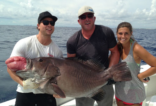 Holding a big warsaw grouper, 60 pounds plus