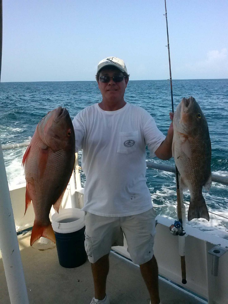 Mangrove and mutton snapper being held up just after landing
