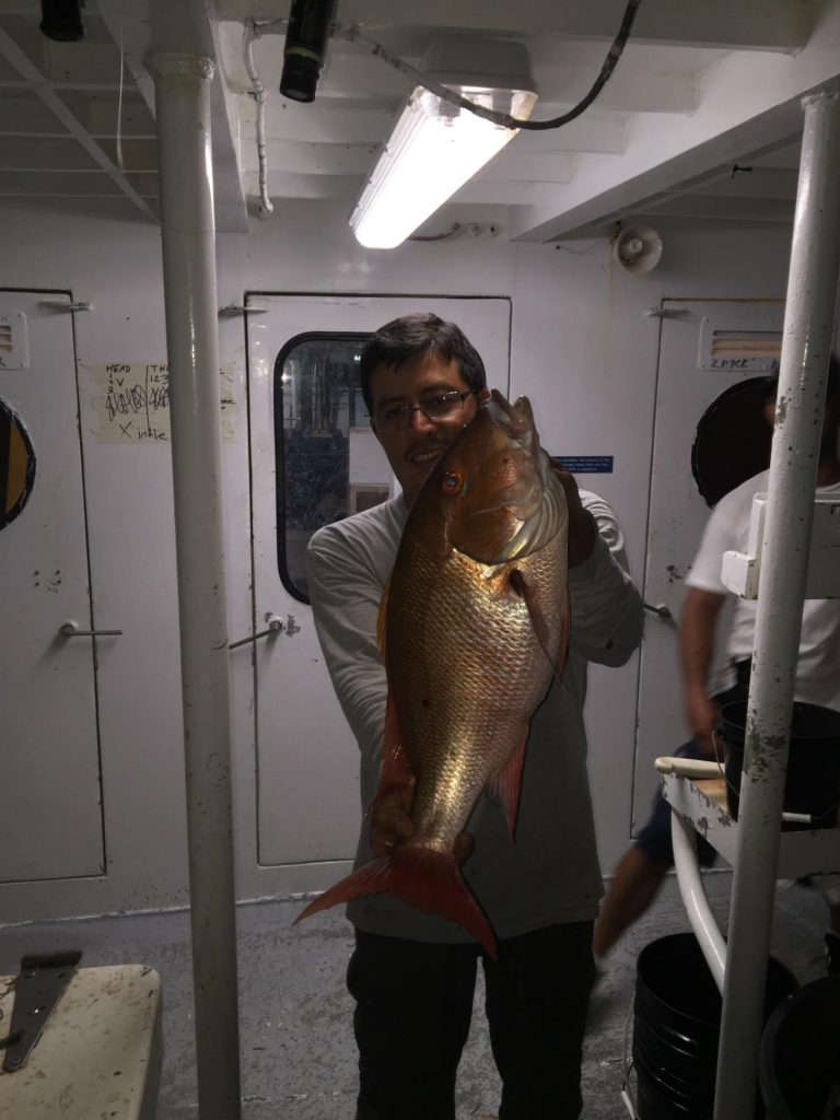 Guy holding a nice mutton just caught night anchor fishing in Ft Lauderdale
