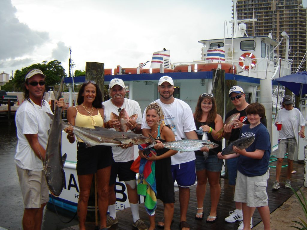 Nice family posing with their catch after their fishing trip. Some nice fish are biting in Fort Lauderdale.