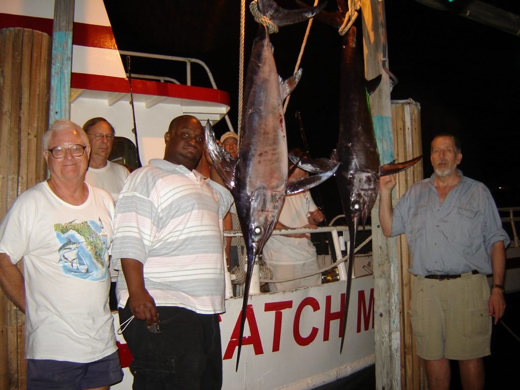 Back at the dock with the swordfish we caught on our night swordfishing charter
