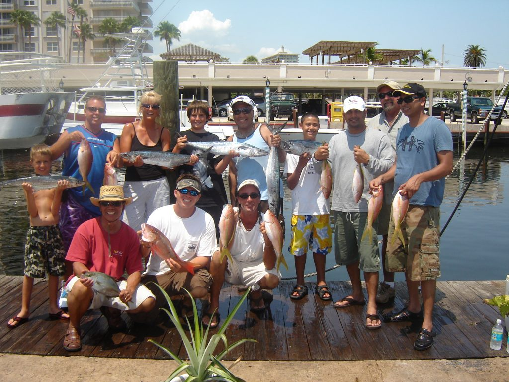 fun folks posing with their catch after the fishing trip