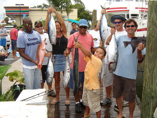 Group holding up their catch from our party boat fishing trip