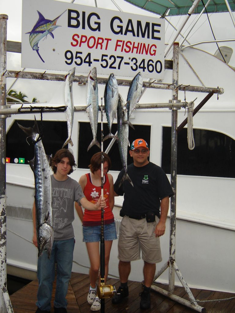 Family posing with their catch at the dock in Fort Lauderdale