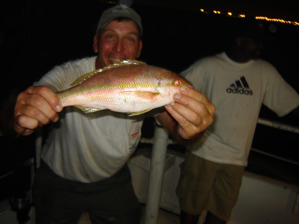 Crazy Capt Chuck with a yellowtail snapper he just caught