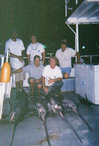 Guys taking a quick snapshot of their awesome catch on our swordfishing charter