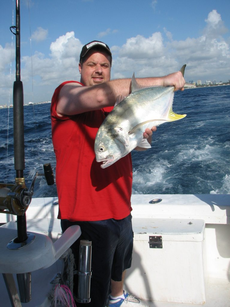 Happy guy with a jack crevale he just caught on our offshore fishing charter