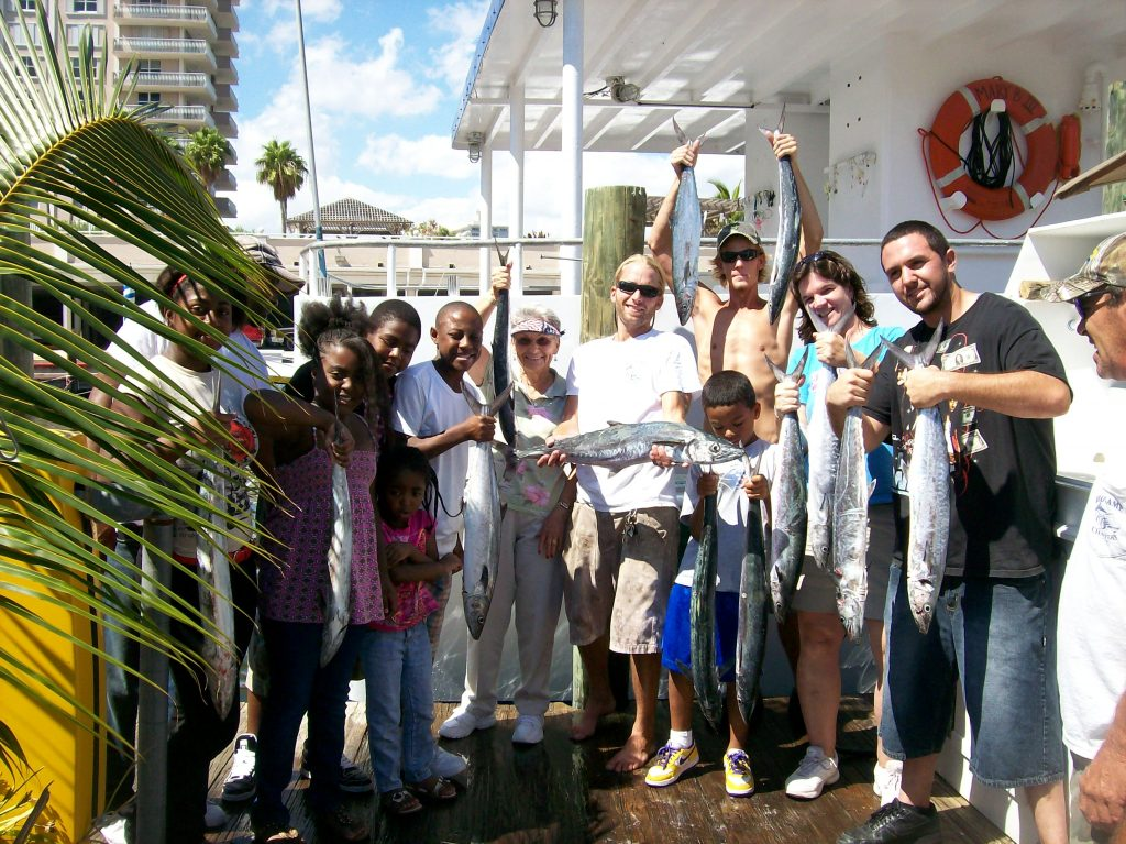 Group posing with their drift fishing catch