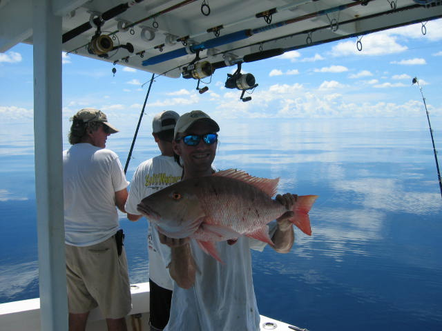 Holding a nice mutton snapper