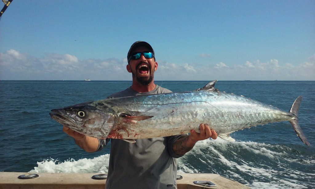 Huge kingfish caught trolling on the reef.