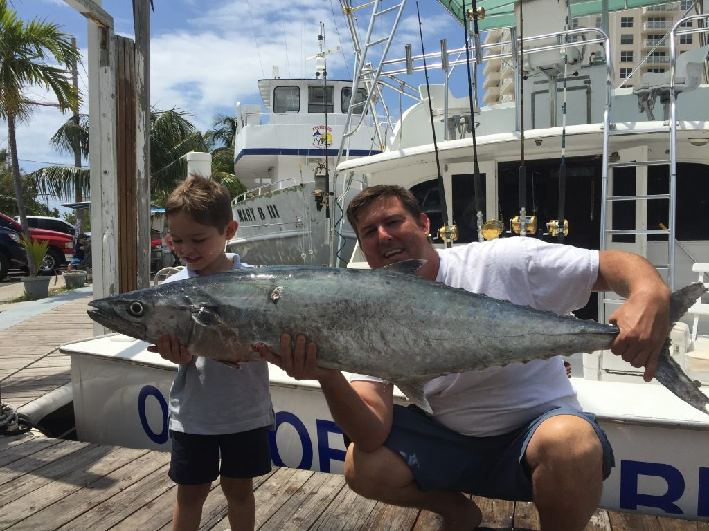 Kid with monster kingfish caught on sportfishing charter