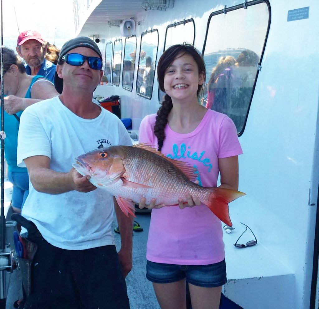 Nice snapper caught by young lady angler