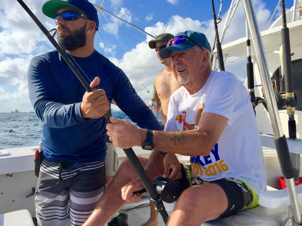 Sailfish on the line, angler in the chair