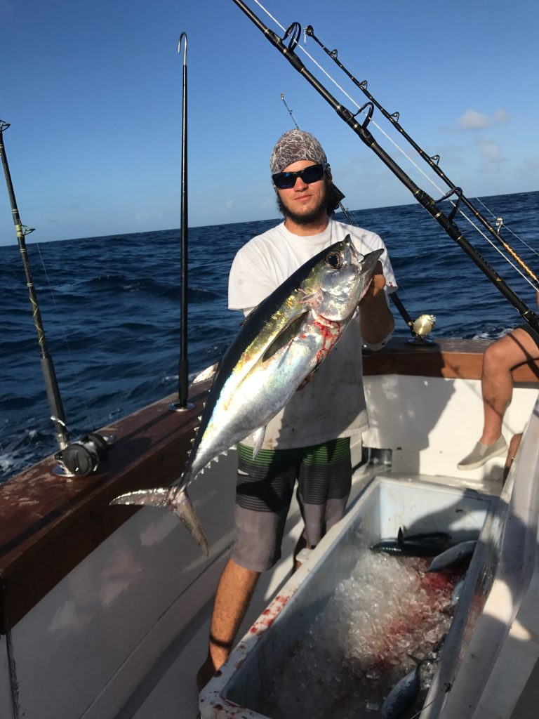 Matt holding a nice blackfin tuna just caught trolling.