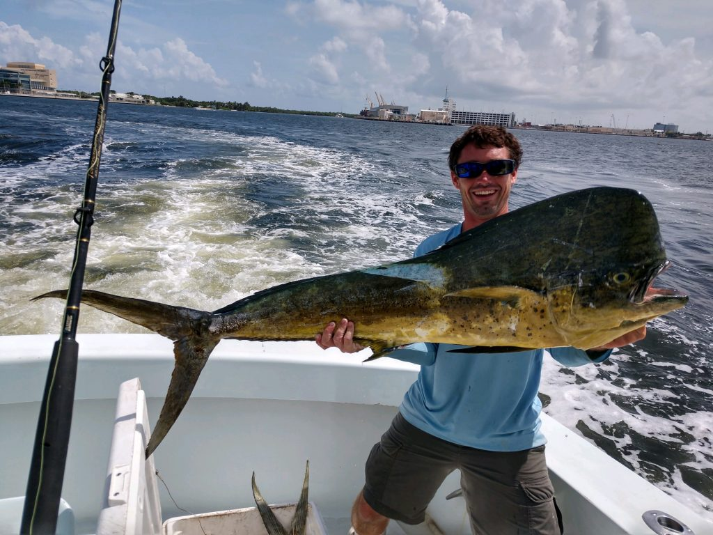 Ryan holding a big mahi-mahi caught on our sportfishing charter.