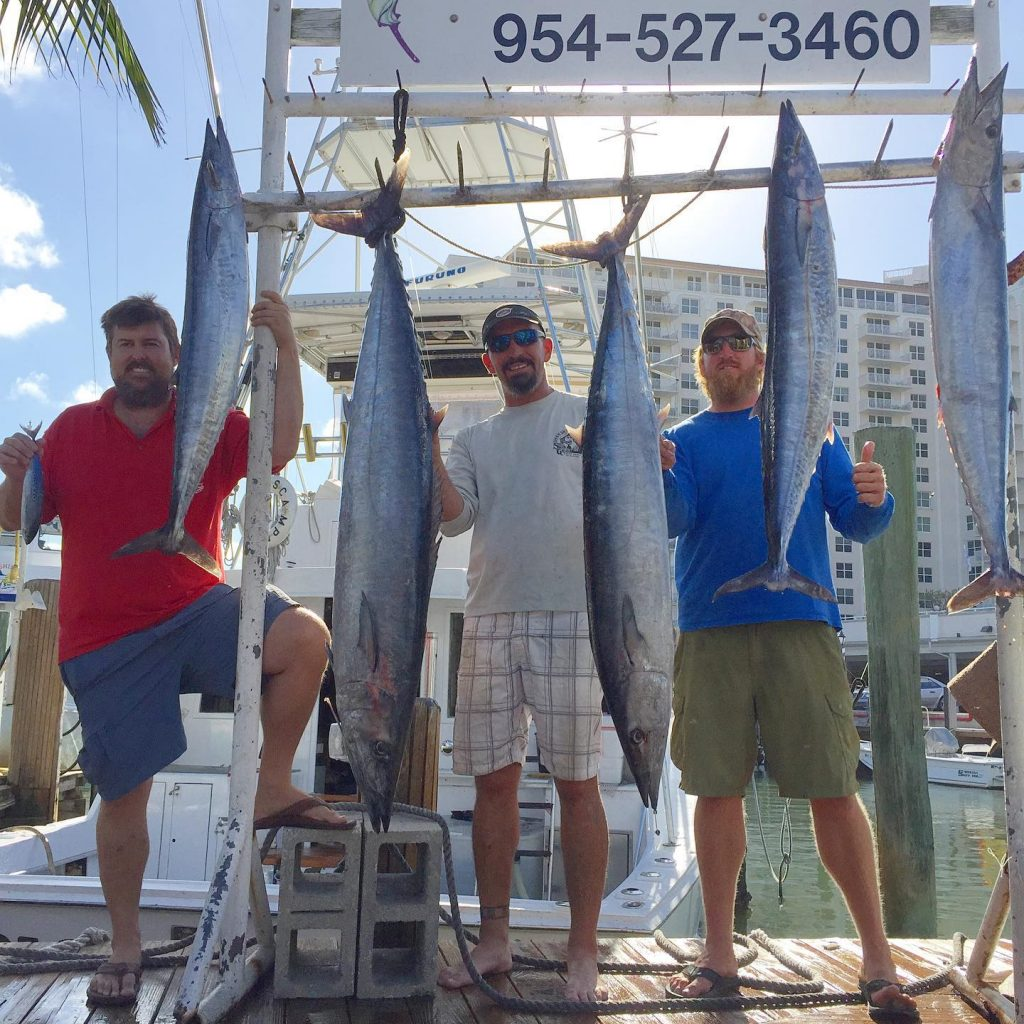 five wahoo hanging up at the dock in Fort Lauderdale